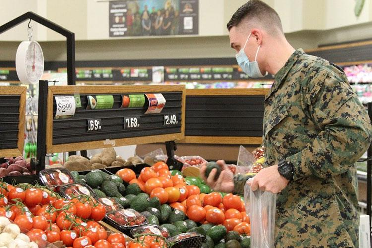 A Marine shops for produce at the Naval Air Station Oceana, Virginia, Commissary. (DeCA photo: Keith Desbois)
