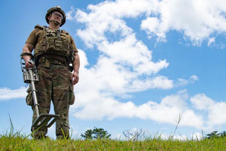 Tech. Sgt. Benjamin Dickson, an Explosive Ordnance Disposal technician from the 18th Civil Engineer Squadron, uses a metal detector during an Improvised Explosive Device training event on Kadena Air Base, Japan, May 26, 2021. Dickson used a metal detector after the IED had detonated, to conduct a post-blast assessment. (U.S. Air Force photo by Airman 1st Class Yosselin Perla)