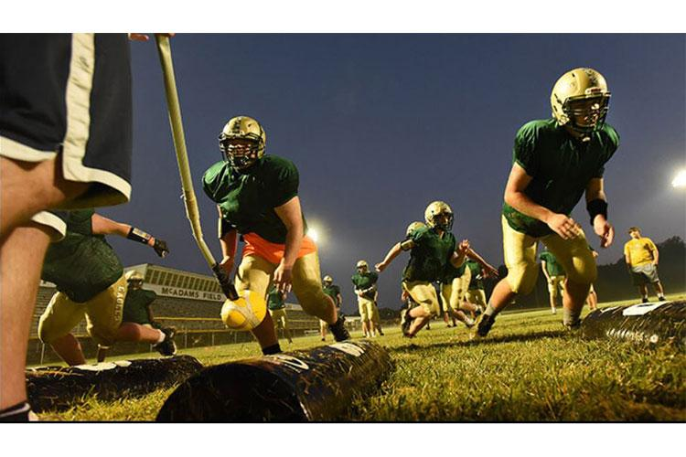 Linemen from the Fort Knox Eagles football team practice reaction drills in August 2021, learning to anticipate moving when the ball moves (Photo by: Eric Pilgrim, Fort Knox).