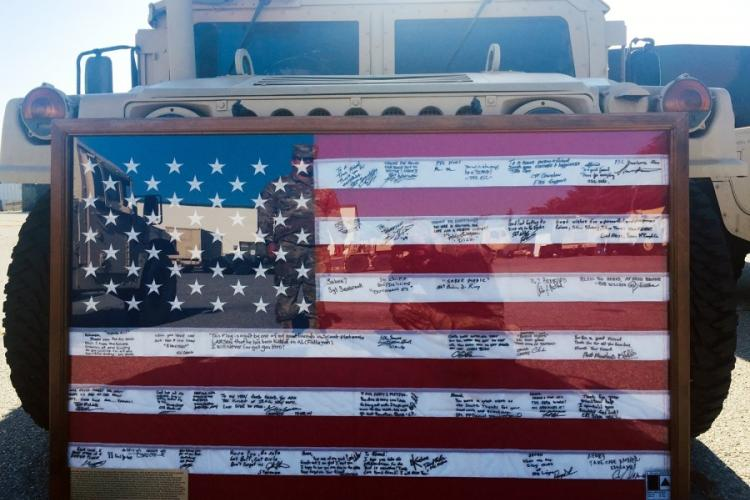 A U.S. flag that survived for more than a decade after it was hidden from insurgents in Iraq is displayed during a ceremony at Fort Bliss, Texas, Sept. 11, 2019. AHMED ALSAEDI