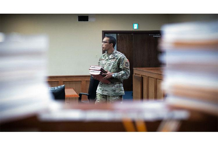 U.S. Air Force Senior Airman Dorien A. Hamilton, 18th Wing Judge Advocate military justice paralegal, prepares to review court records, evidence, and administrative case files on Kadena Air Base, Japan, June 19, 2020. The 18th Wing Office of the Staff Judge Advocate was awarded the 2019 Legal Office of the Year Award, which recognizes an outstanding legal office whose legal support best exemplifies the JAG Corps' mission. (U.S. Air Force photo by Tech. Sgt. Daniel E. Fernandez)