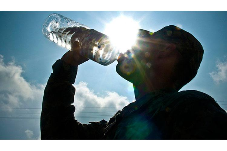 Dehydration is caused by not drinking enough water. The amount of water necessary to keep someone hydrated depends greatly on the weather, the amount of physical activity, and an individual's physical fitness level. The symptoms of dehydration include lethargy, headaches, and lack of energy. (Photo by U.S. Army Sgt. Timothy R. Koster)