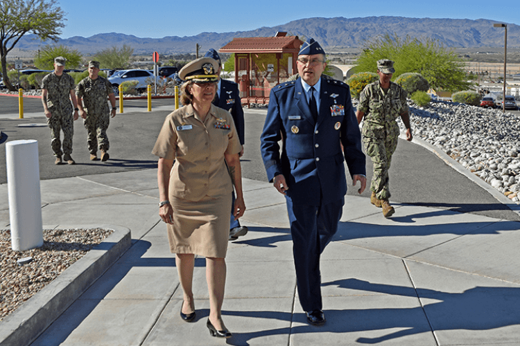 Air Force Maj. Gen. Lee Payne (right) is escorted into Naval Hospital Twentynine Palms by hospital commanding officer, Navy Capt. Nadji Hariri, for a site visit on the launch of MHS GENESIS, the military's new electronic record-keeping system, April 17. (U.S. Navy photo by Dave Marks)