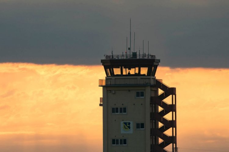 An air traffic controller with the 374th Operations Support Squadron looks out from the control tower at Yokota Air Base, Japan, June 4, 2017.  YASUO OSAKABE/U.S. AIR FORCE PHOTO