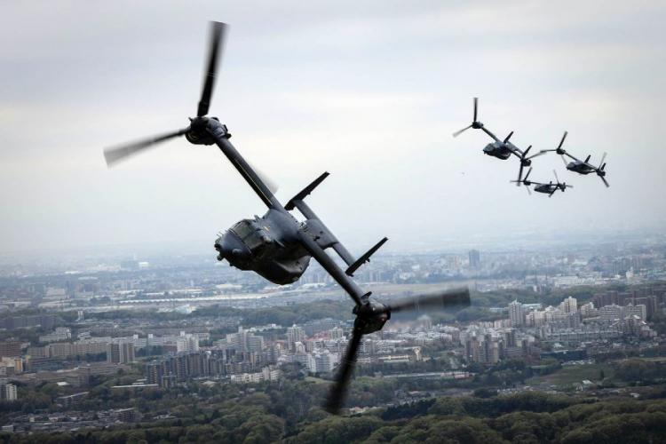 Air Force CV-22 Ospreys assigned to the 353rd Special Operations Group fly over Tokyo, April 5, 2018.  JOSEPH PICK/U.S. AIR FORCE PHOTO