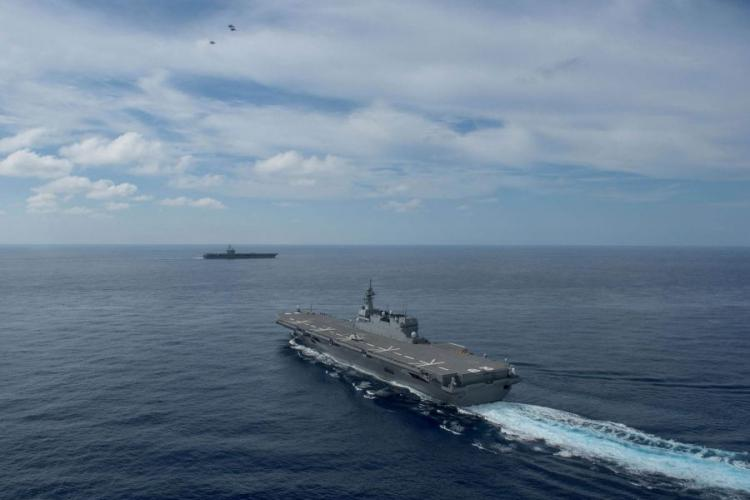 Japan's Defense Ministry canceled a port call at Busan by the helicopter carrier JS Izumo, pictured here during an exercise with the U.S. Navy on June 15, 2017, due to a dispute with South Korea.  NATHAN BURKE/U.S. NAVY PHOTO