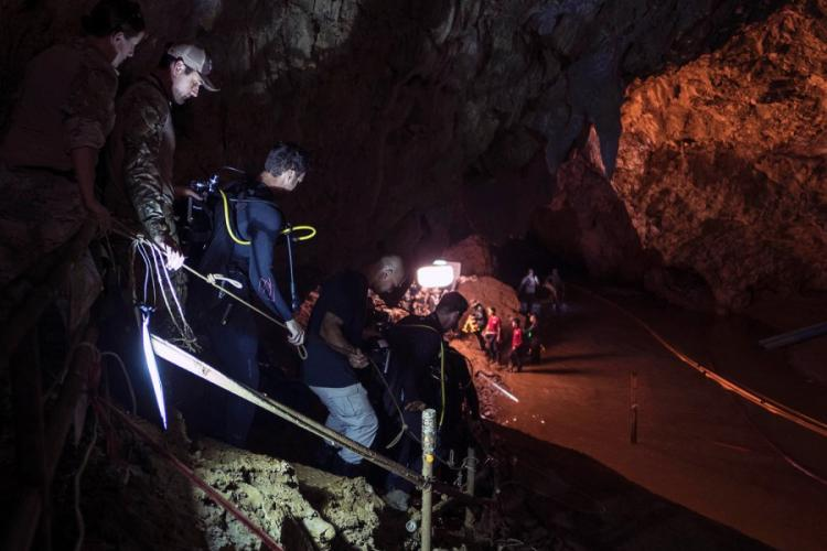 Air Force Tech Sgt. Kenny O'Brien, third from left, descends into Tham Luang cave in Chiang Rai, Thailand, ahead of dive operations on July 2, 2018. JESSICA TAIT/U.S. AIR FORCE