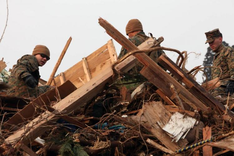 U.S. Marines of the 31st Marine Expeditionary Unit pick up debris April 2, 2011, during a disaster relief mission at Uranohama Port, Oshima Island, Japan, in support of Operation Tomodachi. BRENNAN O'LOWNEY/U.S. MARINE CO