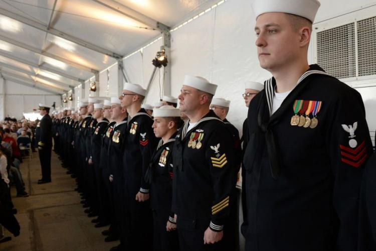 Sailors wearing red or yellow stripes stand in formation during the commissioning ceremony of the USS South Dakota on Feb. 2, 2019. STEVEN HOSKINS/U.S.NAVY