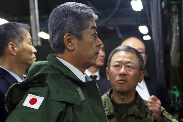 Japanese Defense Minister Takeshi Iwaya tours the command post during Yama Sakura 75 at Camp Higashi-Chitose, Hokkaido, Japan, Dec. 15, 2018. ERICA EARL/U.S. ARMY