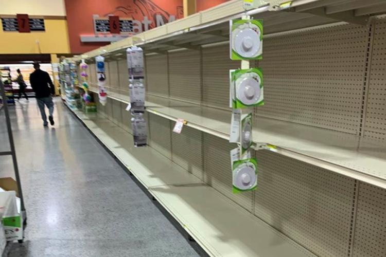 Commissary shelves that usually hold toilet paper are empty at Marine Corps Air Station Iwakuni, Japan, Sunday, March 1, 2020. KIERSTEN WINNEGAR