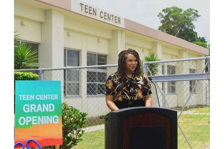 Laura Jefferson, 18th Force Support Squadron teen program coordinator, gives opening remarks at the grand reopening of the new Teen Center June 24, 2020, at Kadena Air base, Japan. After being closed due to moving buildings, renovations, and COVID-19 restrictions, the Teen Center on KAB officially reopened as part of a new beginning in a new setting. (U.S. Air Force photo by Staff Sgt. Benjamin Sutton)