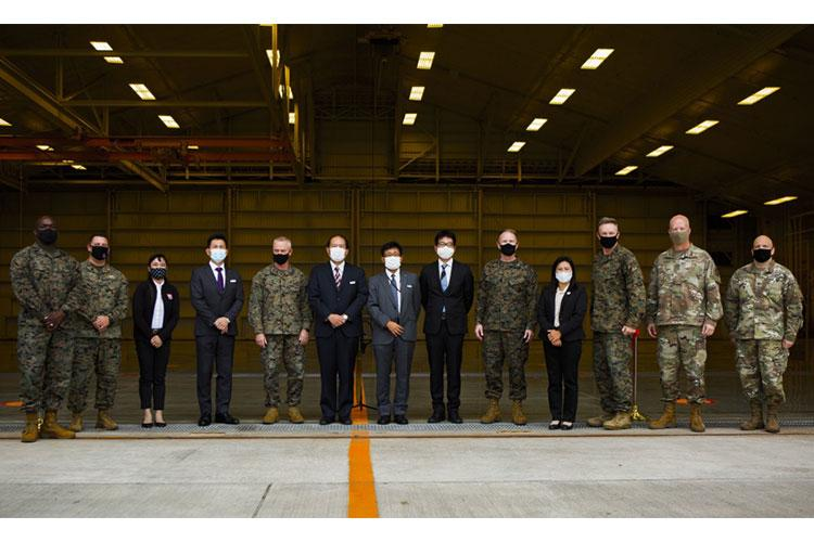U.S. military leaders and Tokyu Construction Company representatives pose for a photo during a ribbon cutting ceremony on Kadena Air Base, Okinawa, Japan, Nov. 24, 2020. The ceremony celebrated the grand opening of a hangar operated by Marine Wing Liaison Kadena (MWLK). MWLK provides comprehensive operational and logistical support to local and deployed U.S. Marine Corps and U.S. Navy squadrons operating at Kadena Air Base. (U.S. Marine Corps Photo by Cpl. Christopher A. Madero)
