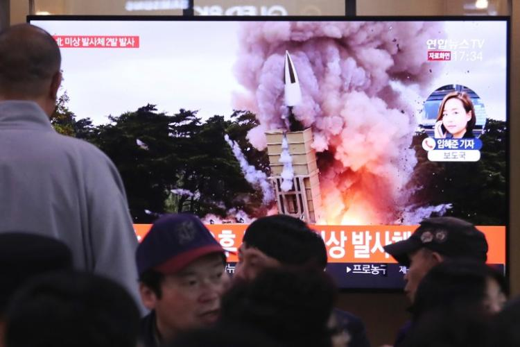 People watch a TV showing a file image of an unspecified North Korea's missile launch during a news program at the Seoul Railway Station in Seoul, South Korea, Thursday, Oct. 31, 2019. AHN YOUNG-JOON/AP