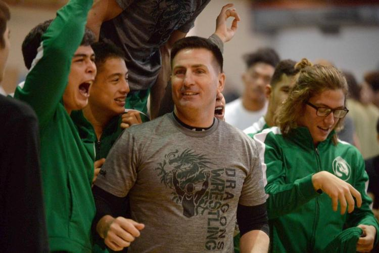 Kubasaki coach Brent Cook and his Dragons celebrate their repeat Far East Division I individual freestyle team title. DAVE ORNAUER/STARS AND STRIPES