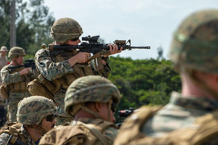 U.S. Marines conduct the table one range during 3rd Marine Division Rifle Squad Competition at Camp Hansen, Okinawa, Japan, Jan. 15.