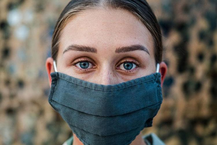Air Force Senior Airman Olivia Grooms, a 379th Air Expeditionary Wing broadcast journalist, poses for a portrait at Al Udeid Air Base in Qatar. (U.S. Air Force photo by Staff Sgt. Lauren Parsons)