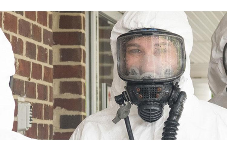 Airman Faith Coffelt, 192nd Medical Group Detachment 1 medical technician, decontaminates her chemical suit June 9, 2020, at Paramount Senior Living in Fredericksburg, Virginia. Coffelt is part of a regional team mobilized to conduct COVID-19 testing at point prevalence sites throughout the state.