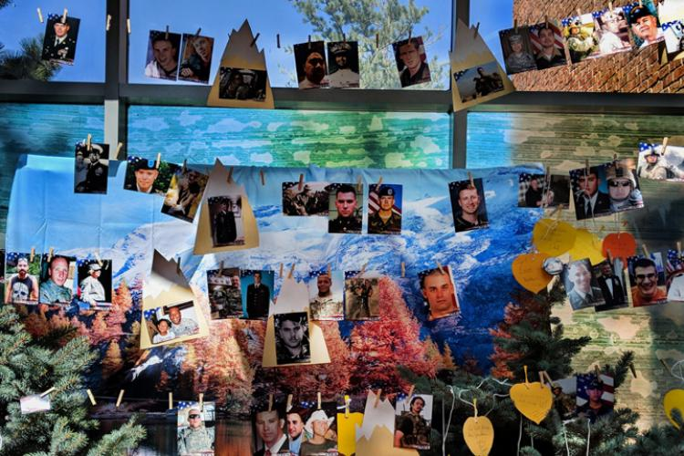 Young military family members at a Tragedy Assistance Program for Survivors Good Grief Camp in Denver, Colorado, created this collage to memorialize their lost loved ones. (U.S. Air Force photo by Senior Airman Arielle Vasquez)