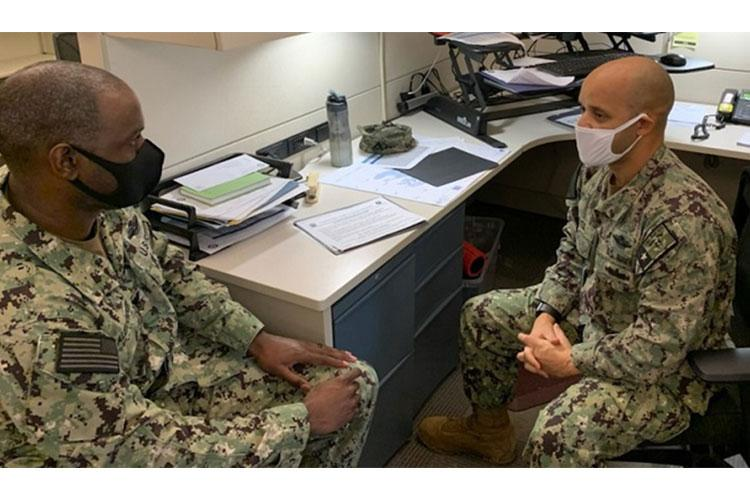 Navy Senior Chief Petty Officer Luis Reyes (right) from Ft. Sam Houston in San Antonio, mentors Navy Hospital Corpsman First Class Jon Alexander, who is stationed at the Navy Medicine Training Support Command there. Reyes is the senior chief instructor of the Hospital Corpsmen Program and trains young officers for the most part. He relies on four pillars of mentoring: family, finances, fitness, and faith. (Photo Courtesy of Navy Senior Chief Petty Officer Luis J. Reyes.)