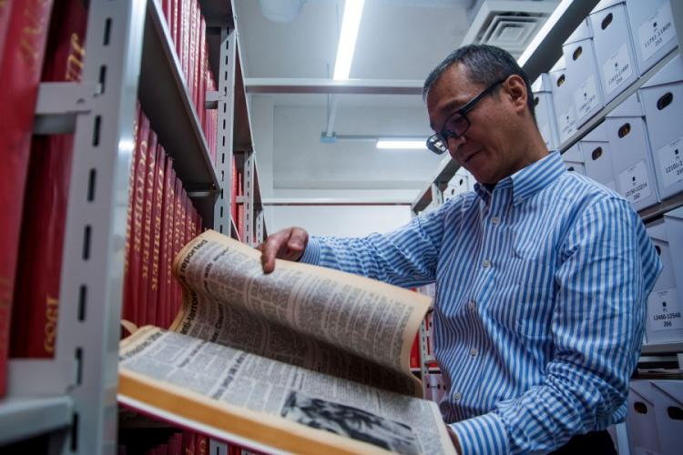 Stars and Stripes Pacific librarian Norio Muroi looks through the newspaper's archives at Hardy Barracks in Tokyo, Thursday, Oct. 31, 2019. THERON GODBOLD/STARS AND STRIPES