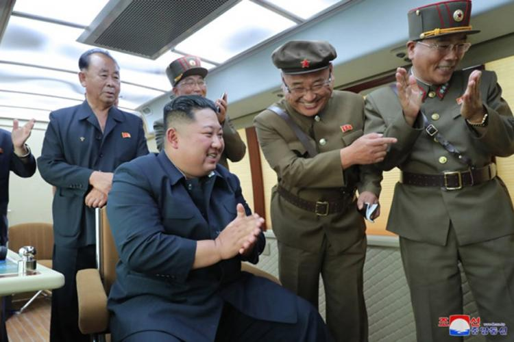 "This undated photo, released by the state-run Korean Central News Agency on Aug. 17, 2019, shows North Korean leader Kim Jong Un observing the test-firing of a ""new weapon,"" according to KCNA. KCNA"