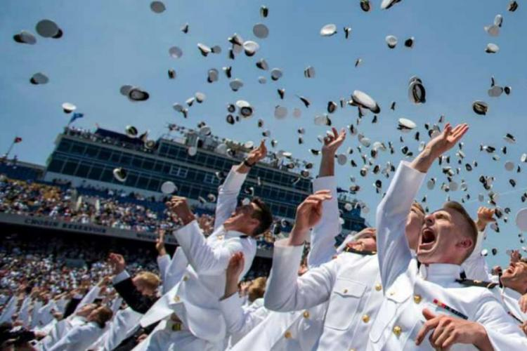 Naval Academy cadets toss their hats in celebration during a graduation ceremony. U.S. NAVY