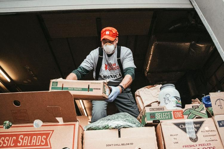 Taking part in Team Rubicon's Neighbors Helping Neighbors campaign, Michael Ilyinky moves food from the Cincinnati Art Museum to La Soupe to help feed those in need during the coronavirus pandemic. The campaign aims to give people a way to help their local community during the coronavirus pandemic while not further spreading the virus. JASON WHITMAN/CONTRIBUTED