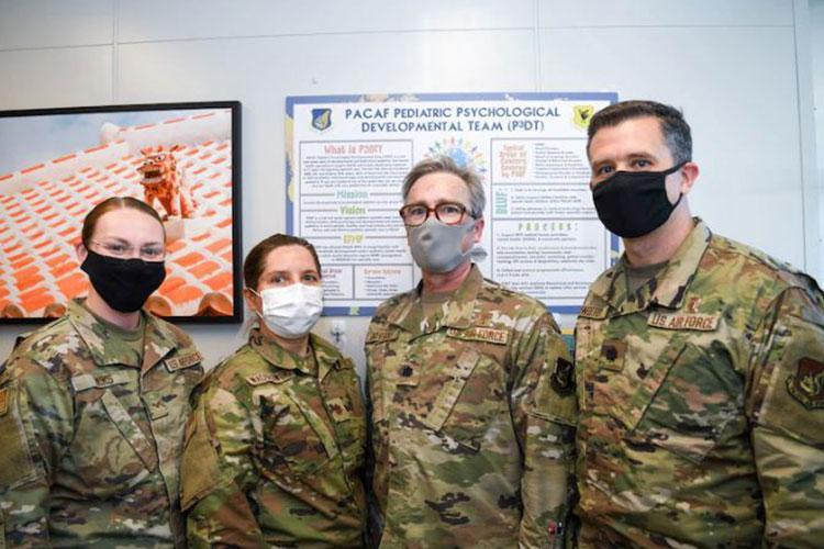 The PACAF Pediatric Psychological Developmental Team with the 18th Healthcare Operations Squadron, poses for a group photo at Kadena Air Base, Japan, April 19, 2021. With the specialty care provided by P3DT, more families with dependents who require pediatric mental health services are able to accept overseas orders or remain overseas. (U.S. Air Force photo by Airman 1st Class Anna Nolte)