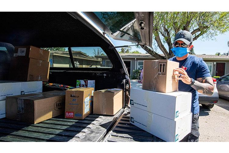 The United States Transportation Command released guidance for moving companies during the COVID-19 pandemic. Movers have been directed to wear face coverings like the above photo, minimize the number of personnel required to move families, and equip themselves to clean surfaces they frequently touch during a move. (U.S. Air Force photo by Tech. Sgt. David W. Carbajal)