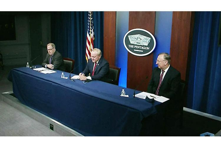 Thomas McCaffery, assistant secretary of Defense for Health Affairs (left) briefs reporters about DoD response efforts to the COVID-19 pandemic. Also participating were Lernes Hebert, deputy assistant secretary of Defense for Military Personnel Policy, and Thomas Muir, director of Washington Headquarters Services. (Department of Defense photo)