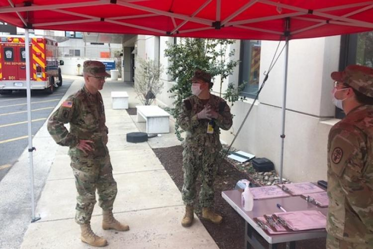 Defense Health Agency director, Army Lt. Gen. Ron Place, visited medical personnel at a COVID-19 screening station outside the Emergency Department at Walter Reed National Military Medical Center on Tuesday, March 31, 2020. WRNMMC instituted additional safety measures including separate entry points for staff and patients to screen for coronavirus symptoms on March 12, 2020. (MHS photo by Navy Lt. Cmdr. Andrew Benson)