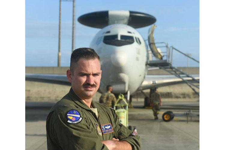 U.S Air Force Staff Sgt. Daniel Propst, 961st Airborne Air Control Squadron air surveillance officer, poses in front of an E-3 Sentry April 27, 2020, at Kadena Air Base, Japan. Propst has the distinction of being the first noncommissioned officer in Pacific Air Forces to qualify as an ASO. The ASO position is historically been a rated aircrew commissioned officer only, typically a Captain or a Major. (U.S. Air Force photo by Staff Sgt. Benjamin Sutton)
