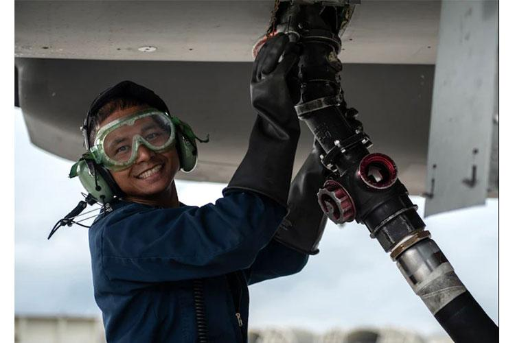 Senior Airman Jason Aungkhaingtun, 18th Aircraft Maintenance Squadron avionics specialist, hooks up a fuel hose to an F-15C Eagle during a super surge exercise at Kadena Air Base, Japan, Oct. 19, 2021. Surge operations provide aircrew and support personnel the opportunity to hone the skills necessary to maintain a ready force, capable of ensuring peace and stability in the Indo-Pacific region. (U.S. Air Force photo by Senior Airman Jessi Monte)