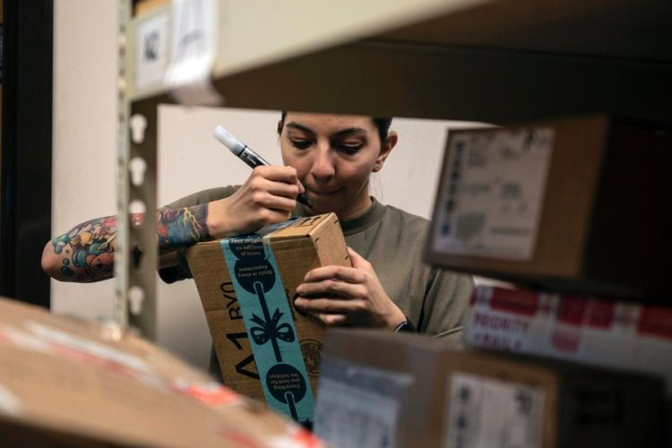 A volunteer helps sort holiday-season mail in the post office at Soto Cano Air Base, Honduras, Jan. 2, 2019. DESTINEE SWEENEY/U.S. AIR FORCE
