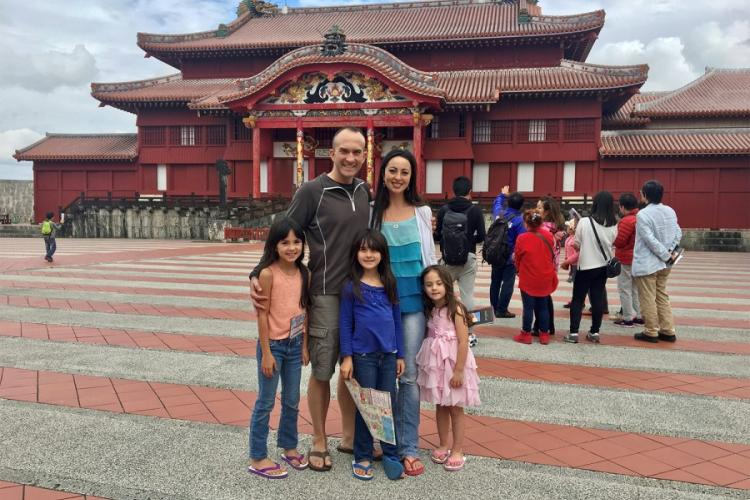 Marine Corps Maj. Indigo Gregory and his wife, Mari Gregory, pose with their daughters at Shuri Castle in Naha, Okinawa, in this undated photo. COURTESY OF MARI GREGORY