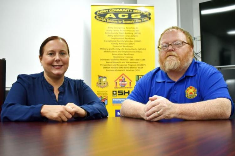 Stan Austin, right, manager of the Family Advocacy Program for U.S. Army Garrison Japan, and Amy Trotto, a FAP specialist at USAG Japan, can help members of the garrison community throughout Japan who are interested in providing stable, loving homes to children through the Emergency Placement Care program. (Photo Credit: Wendy Brown, U.S. Army Garrison Japan Public Affairs)