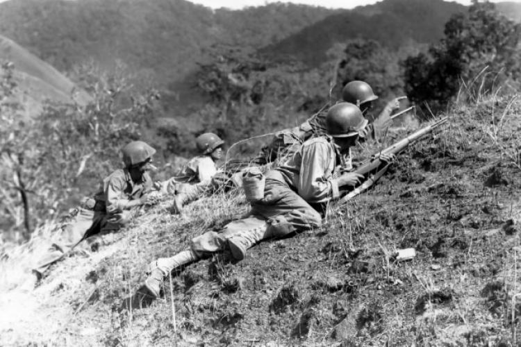 U.S. Soldiers fight their way through Baleta Pass near Baugio, Luzon, Philippines, sometime in late February 1945. (Photo Credit: U.S. Army)