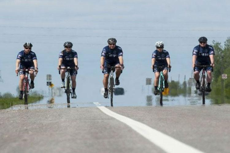 Members of the Air Force Cycling Team ride near Minot Air Force Base, North Dakota in 2017. There are six Minot Air Force Base Airmen on the Air Force Cycling Team, which has more than 150 cyclists Air Force-wide. (Photo by Air Force Airman 1st Class Jonathan McElderry.)