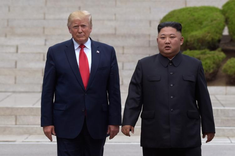 "President Donald Trump, left, meets with North Korean leader Kim Jong Un at the North Korean side of the border at the village of Panmunjom in Demilitarized Zone on June 30, 2019. North Korea threatened Thursday, Dec. 5, to resume insults of Trump and consider him a ""dotard"" if he keeps using provocative language. SUSAN WALSH/AP"