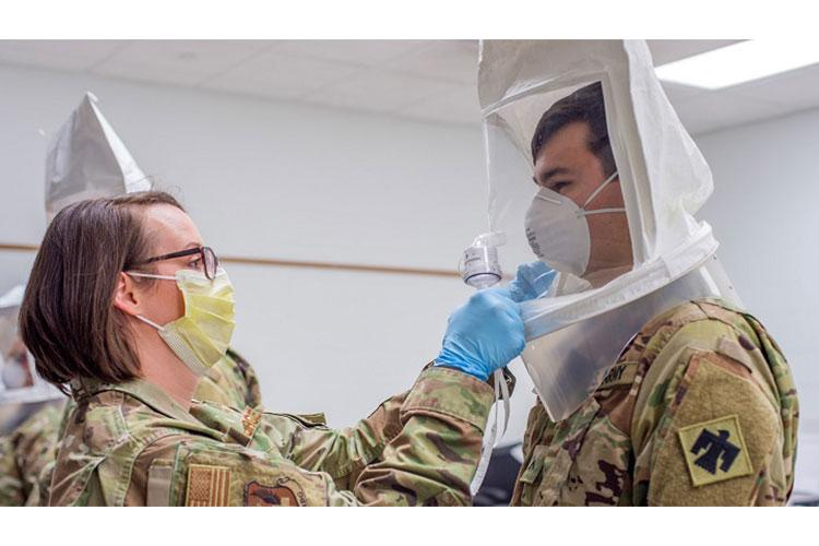 Tech. Sgt. Rebecca Keylon, a bio-environmental engineering technician with the 137th Special Operations Medical Group, Oklahoma Air National Guard, administers a N95 medical mask fit test to Oklahoma Army National Guard Pvt. Connor Boal, a medic with the Oklahoma Army National Guard Medical Detachment, as part of COVID-19 medical response training at the 90th Troop Command Headquarters in Oklahoma City, April 10 - 11. (Oklahoma National Guard photo by Staff Sgt. Brian Schroeder)