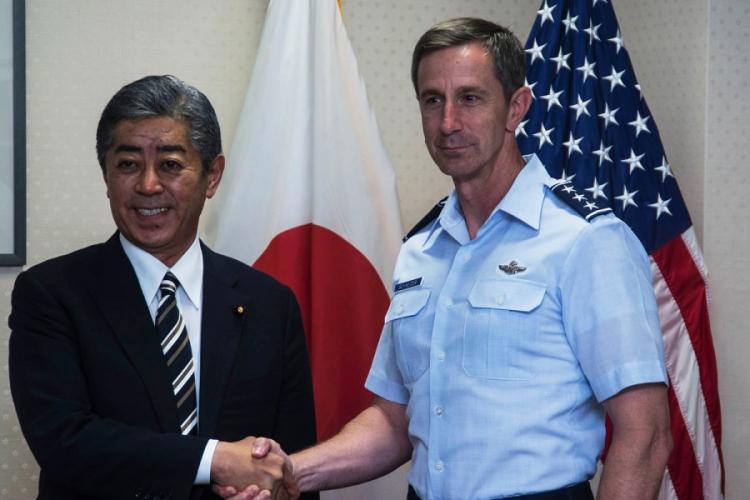 U.S. Forces Japan commander Lt. Gen. Kevin Schneider welcomes Defense Minister Takeshi Iwaya to Yokota Air Base, Japan, Wednesday, June 19, 2019. THERON GODBOLD/STARS AND STRIPES