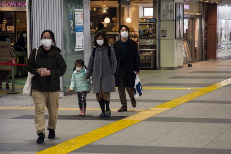 Commuters wear masks inside Haijima Station, near Yokota Air Base, Japan, Wednesday, Feb. 26, 2020.  THERON GODBOLD/STARS AND STRIPES