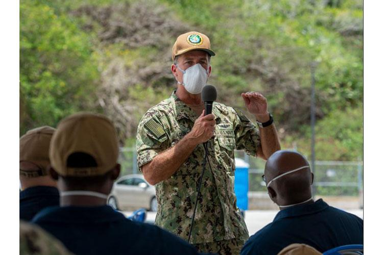 NAVAL BASE GUAM (MAY 2, 2020) U.S. Pacific Fleet commander Adm. John C. Aquilino addresses Sailors assigned to the aircraft carrier USS Theodore Roosevelt (CVN 71), May 2, 2020. Theodore Roosevelt's essential watch standers and cleaning team conducted a crew swap starting April 29, turning over a clean ship to a COVID-negative crew after completion of their off-ship quarantine or isolation. (U.S. Navy photo by Mass Communication Specialist 3rd Class Dartanon D. Delagarza/Released)