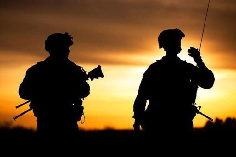Soldiers from Delta Company, 2-108th Infantry Battalion, 27th Brigade, conduct a partnered-Afghan National Security Force security patrol at dusk. (Photo by Army 1st Lt. Jason Uhlig.)