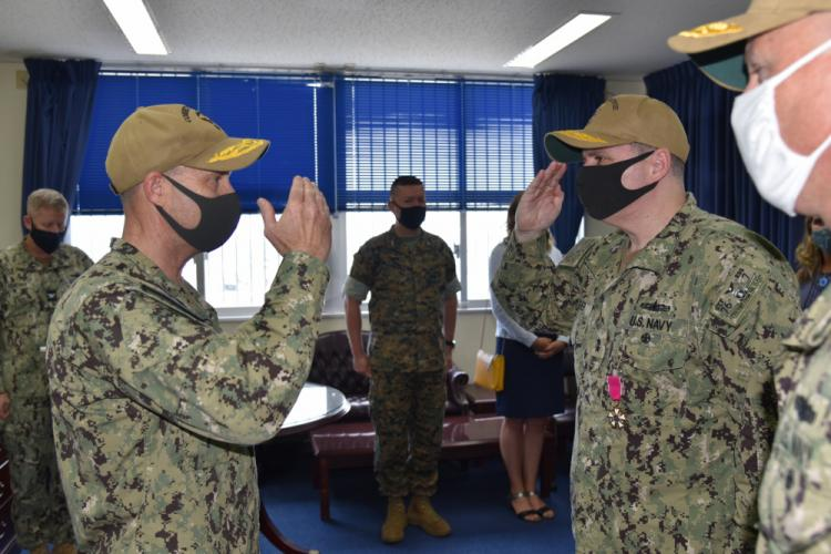 Rear Adm. Fred Kacher, salutes, Vice Adm. Bill Merz, commander, U.S. 7th Fleet, during a change of command ceremony for Expeditionary Strike Group (ESG) 7 on Naval Base White Beach. Rear Adm. Chris Engdahl relieved Kacher as ESG 7 commander. ESG 7 is forward deployed in the U.S. 7th Fleet area of responsibility to enhance interoperability with allies and partners and serve as a ready response force to defend peace and stability in the Indo-Pacific region. (U.S. Navy photo Lt. Cmdr. Sherrie Flippin)