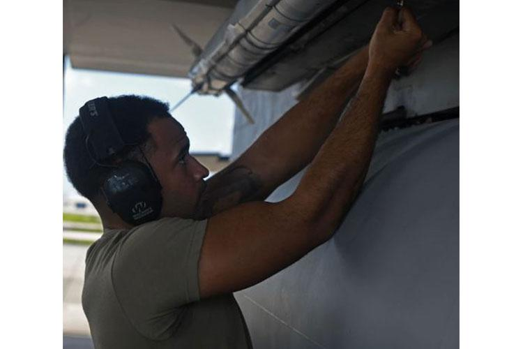 U.S. Air Force Staff Sgt. Jacob Wigfall, 44th Aircraft Maintenance Unit weapons load crew team chief, secures an AIM-9 Air-to-Air Missile onto an F-15C Eagle Oct. 30, 2020, at Kadena Air Base, Japan. Wigfall and his two teammates represented the 44th AMU in the 3rd Quarter's Load Crew of the Quarter Competition between the 44th and 67th AMUs. (U.S. Air Force photo by Tech. Sgt. Benjamin Sutton)