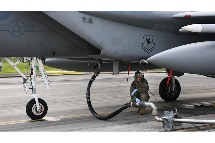 A maintainer from the 18th Aircraft Maintenance Squadron prepares to fuel an F-15 Eagle during Exercise Rumrunner at Marine Corps Air Station Futenma, Japan, Jan. 10, 2020. Airmen from the 18th Wing operate in a safe and environmentally conscious manner and adhere to strict standards set by Department of Defense and host governments at all times. (U.S. Air Force photo by Staff Sgt. Benjamin Raughton)