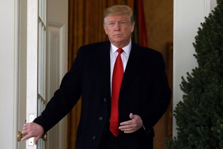 President Donald Trump walks from the Oval Office to speak in the Rose Garden of the White House, Friday, Jan 25, 2019, in Washington. (EVAN VUCCI/AP)