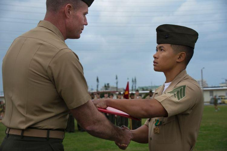 Marine Sgt. David Nguyen Lam, right, is awarded the Navy and Marine Corps Achievement Medal at Camp Foster, Okinawa, Friday, Feb. 1, 2018. Lam gave first aid to an airman after a New Year's Eve motorcycle accident. (CARLOS VAZQUEZ/STARS AND STRIPES)